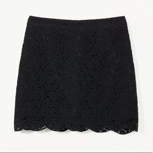 Talula Lace Scalloped Mini Skirt from Aritzia